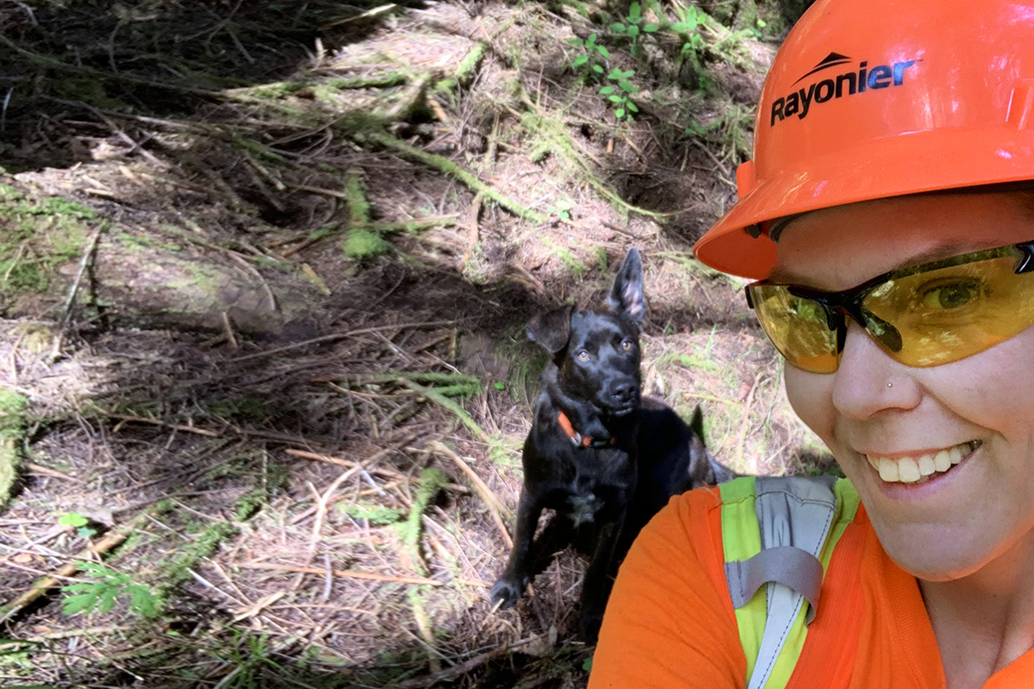 Woman in Forestry with working Dog