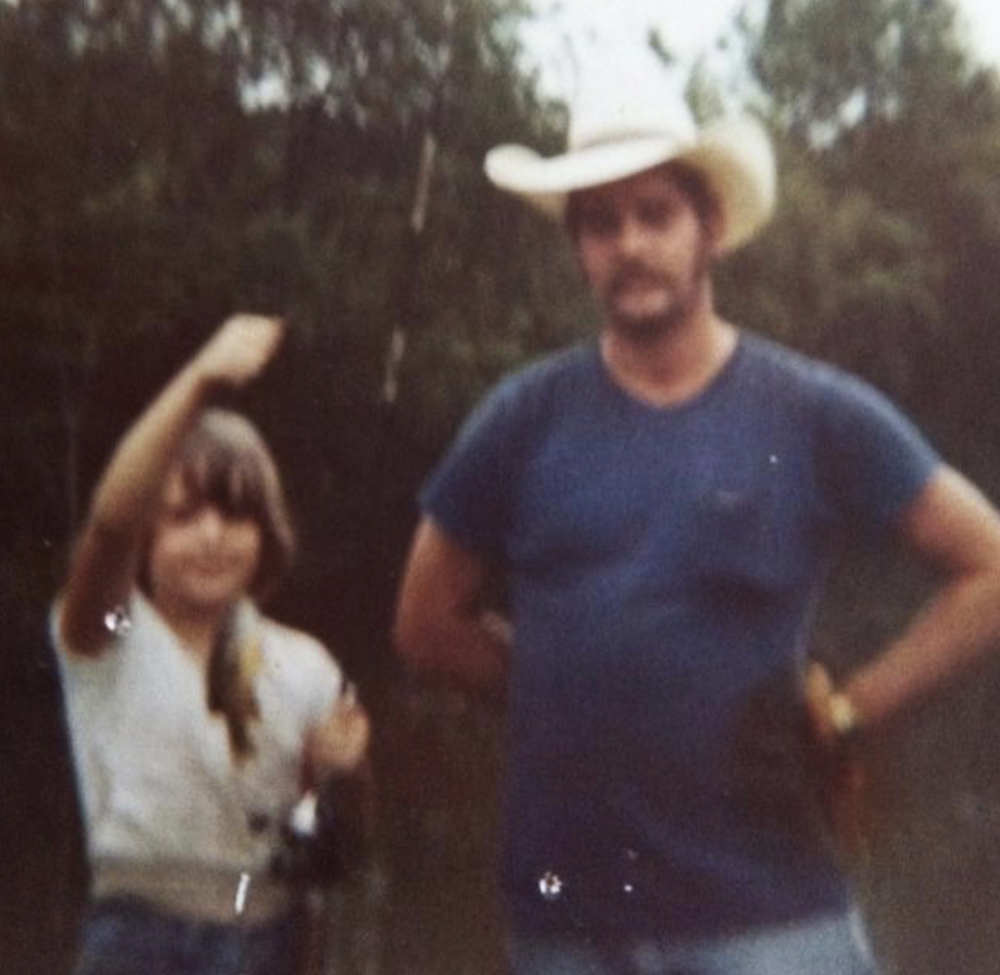 Laura fishing with her father during childhood