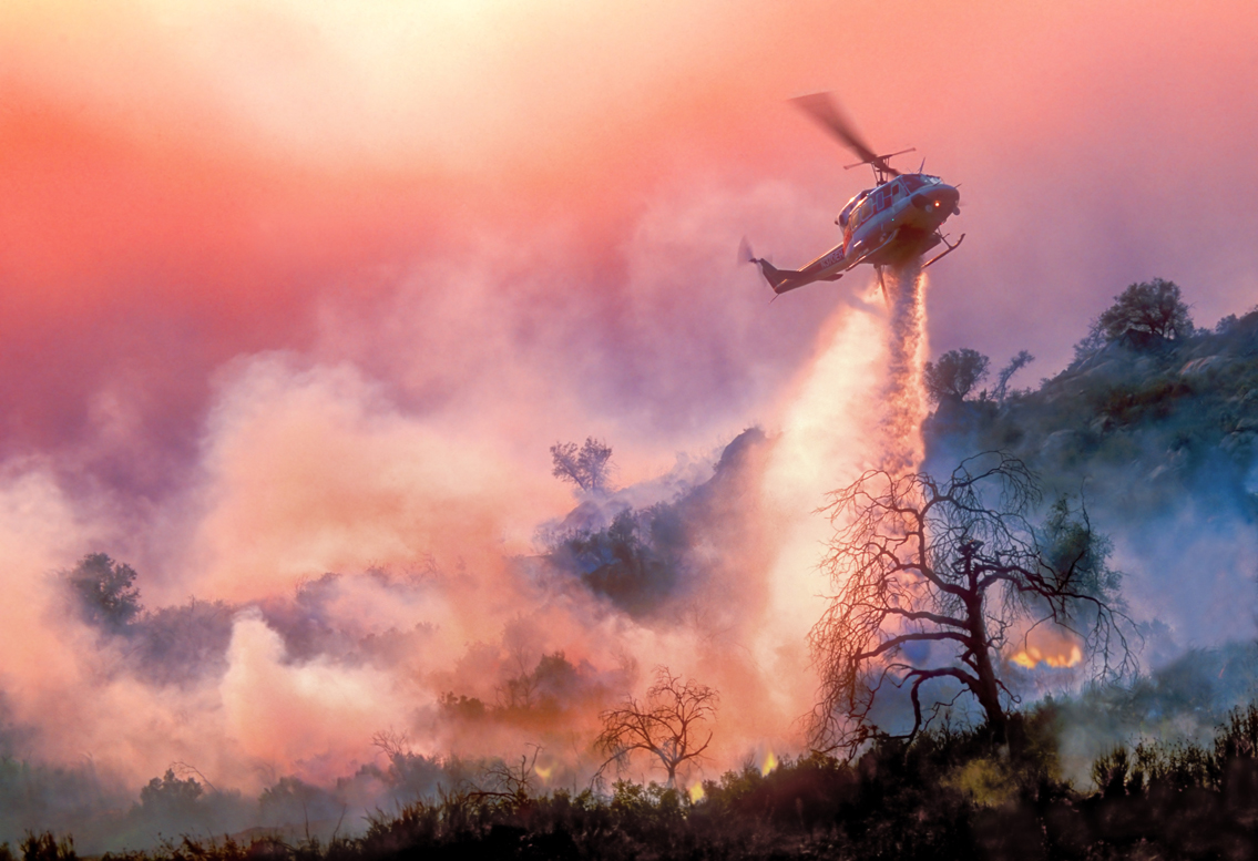 Helicopter drops water on California wildfire